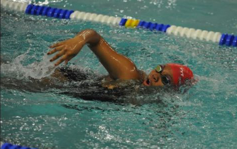 Freshman Maijanai Johnson swimming in her event during the winter season